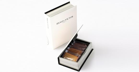 ブランドを象徴する手帳形の美しいボックス