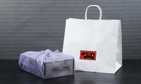 米沢牛プレミアムジャーキー3袋 ・米沢牛入りプレミアムドライソーセージ1袋の紙袋画像