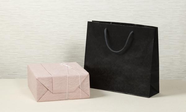 有機極上こしひかり「ひかり太陽米」と伝統工芸「九谷焼」夫婦茶碗セットの紙袋画像