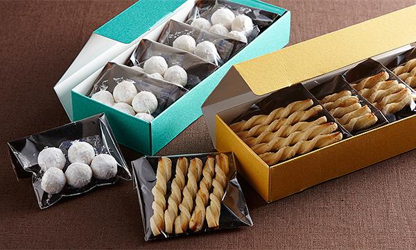 「佐渡チーズと佐渡番茶の淡塩スティックパイ」「佐渡レモンと佐渡バターの小雪ぼーる」の箱画像